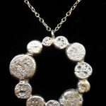 Item 34 Silver circle globule necklace