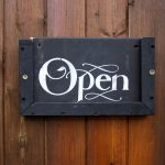 Open sign on wooden door
