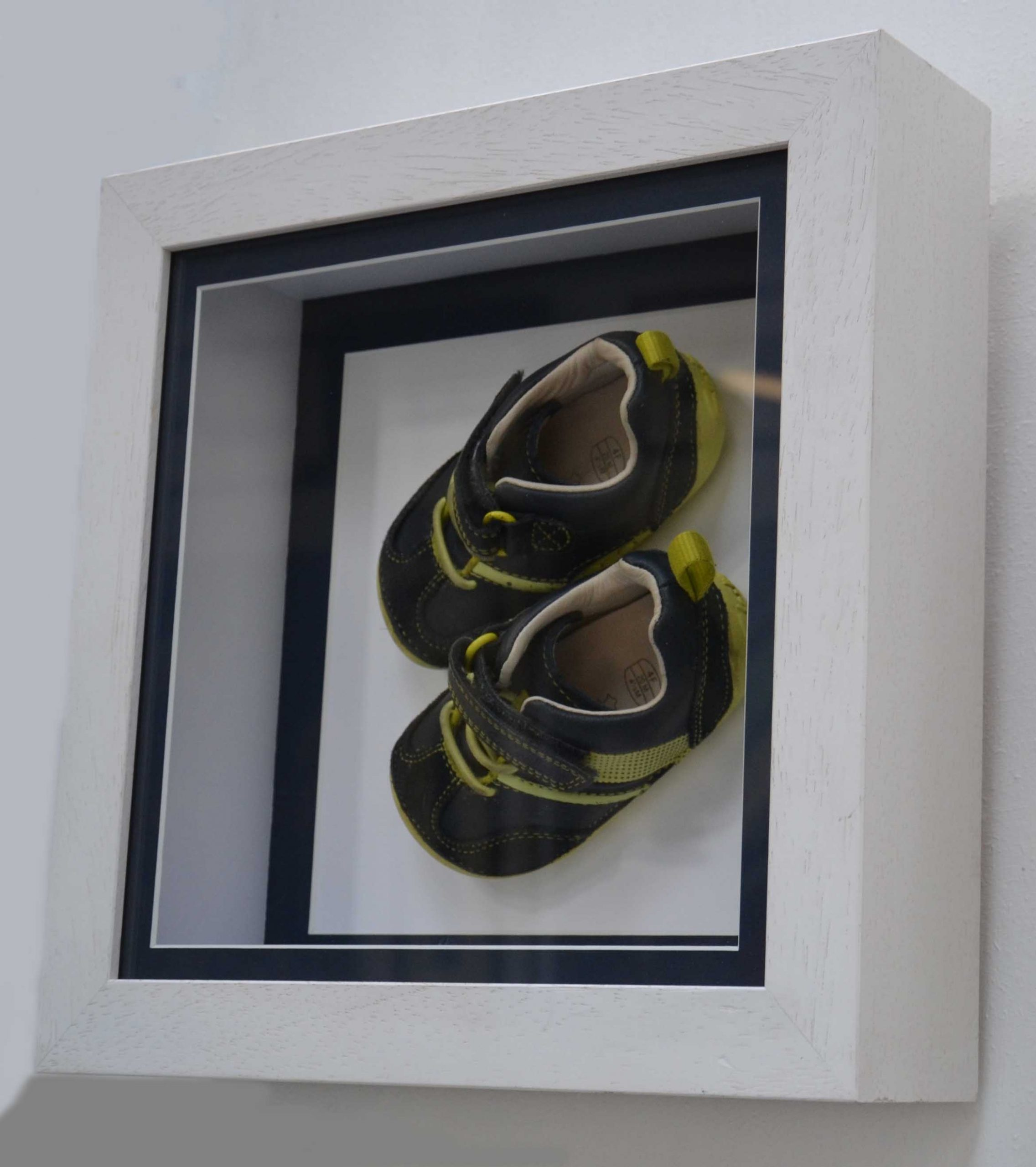 boys baby shoes in frame