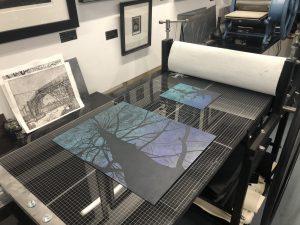 Showing etching press prints
