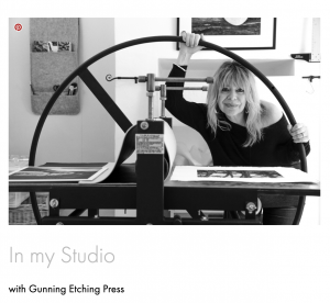 Printmaker with Etching press